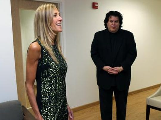 Jacqui Justice, a functional nutritionist, and Mitch Suss, the CEO of NY Health & Wellness, talk Oct. 24, 2014 about their company's new space at 450 Mamaroneck Avenue in Harrison.