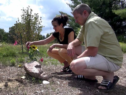 Dan and Michaela Cady visit the grave of their daughter, Kennis, at White Haven Memorial Park in Pittsford.