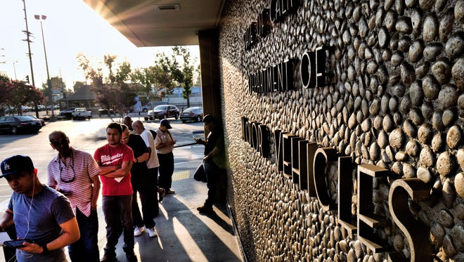 People line up at the California Department of Motor Vehicles prior to opening in Van Nuys on Tuesday. California lawmakers are seeking answers from the Department of Motor Vehicles about hourslong wait times that have prompted public outcry.