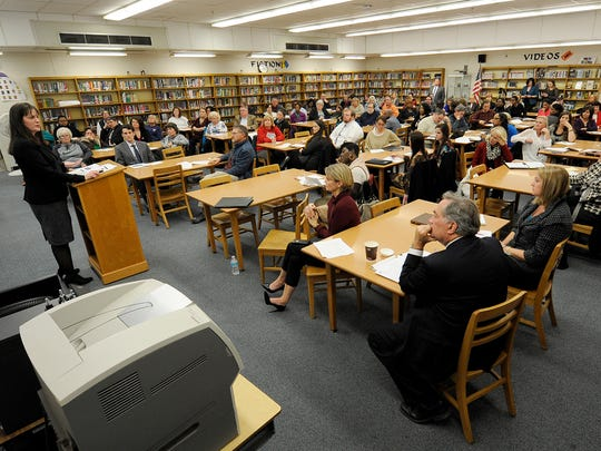 People pack into the library at South Side High School to listen to Tennessee Education Commissioner Candice McQueen during a Tennessee Department of Education town hall meeting in Jackson on Thursday, Dec. 8, 2016.