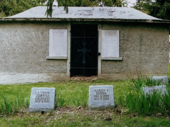 An ancient mausoleum stands in New Berlin Center Cemetery,