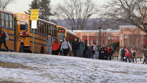 Students head to their buses after school at Tappan