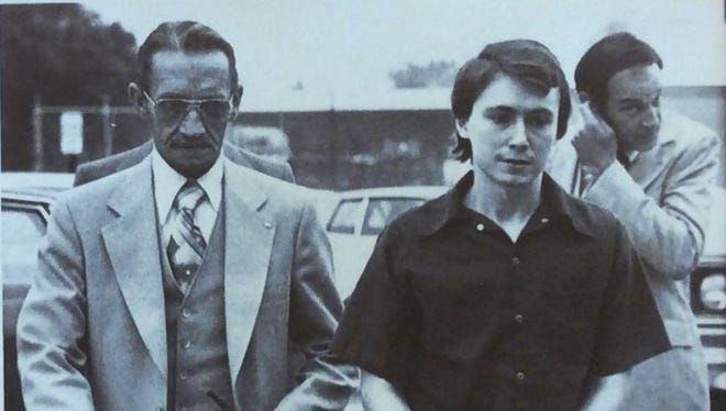 Don Miller, shown in a 1979 photo, is escorted into court for sentencing on two counts of manslaughter.