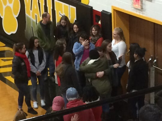 Members of the Paint Valley community find some comfort from each other during a community gathering Sunday to mourn the recent losses of junior Annika Miller and 2015 graduate Chris Fellenstein.