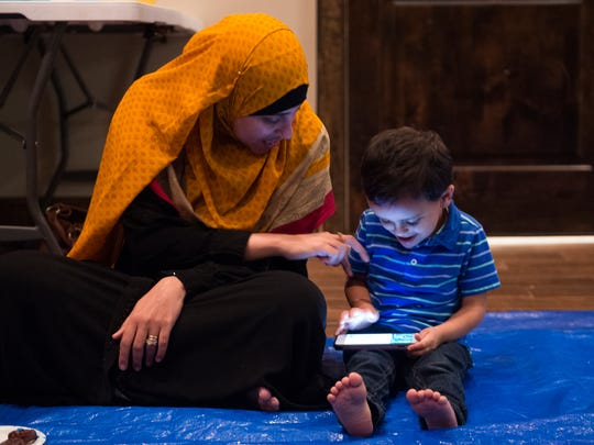Nada Soliman plays with Ammar Mustafa, 3, at Ramadan