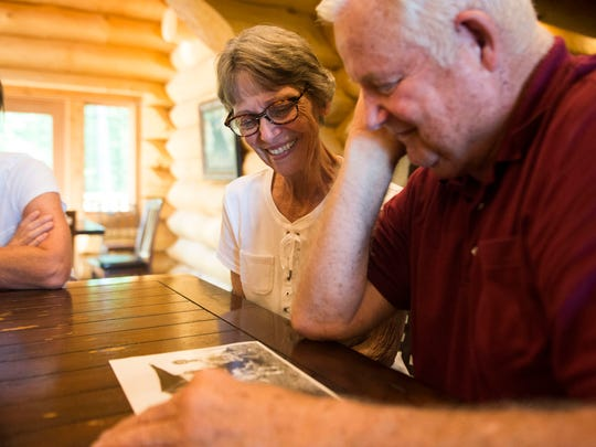 Phil and Joy Huntsinger look at an old family photo while on a family vacation in Gatlinburg on Saturday, June 2, 2018. In 1968 their family of six camped outside the Smokies for a summer while Phil took doctoral classes at the University of Tennessee.