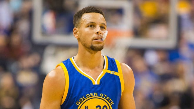 Golden State Warriors guard Stephen Curry looks on from the court in the first half of a game against the Indiana Pacers.