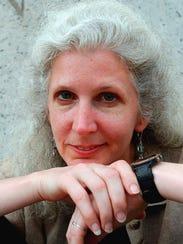 -  Author Andrea Barrett poses outside New York's Museum