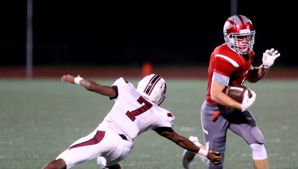Tappan Zee's Nick Violetto evades Nyack's Percy Downing