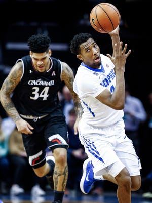 Memphis guard Jeremiah Martin (right) grabs a loose during first half action against Cincinnati at the FedExForum in Memphis Tenn., Saturday, January 27, 2018.