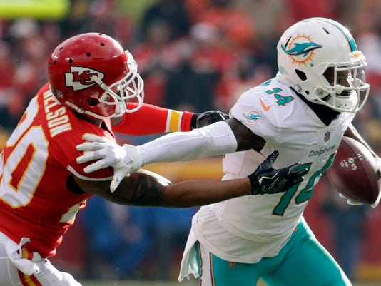 FILE -  In this Dec. 24, 2017, file photo, Miami Dolphins wide receiver Jarvis Landry (14) runs away from Kansas City Chiefs defensive back Steven Nelson (20) during the first half of an NFL football game in Kansas City, Mo. A person familiar with the deal says the Dolphins have agreed to trade Landry to the Cleveland Browns for two draft picks. The person confirmed the trade to The Associated Press on condition of anonymity Friday, March 9, 2018, because under NFL rules, no trades can be completed until Wednesday, the start of the league's new year. (AP Photo/Charlie Riedel, File)