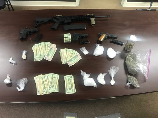 "Officers with the Muncie Police Department's narcotics unit and SWAT team raided a southside home Tuesday night, making two arrests and seizing meth, heroin, cocaine and marijuana, four guns (one reported stolen), drug paraphernalia and ""a large amount of U.S. currency."""