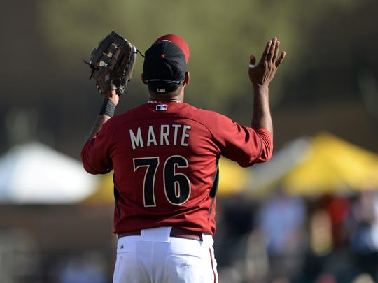 Arizona Diamondbacks third baseman Andy Marte (76) celebrates after defeating the Los Angeles Dodgers at Salt River Fields at Talking Stick in February 2014.