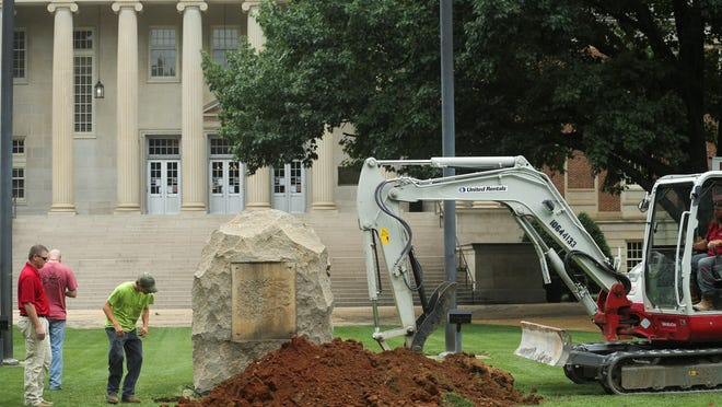 A crew at the University of Alabama begins removing the stone that held a Confederate Memorial plaque in front of the Amelia Gayle Gorgas Library Tuesday, June 9, 2020. The board of trustees had already voted for removal of Confederate memorial plaques Monday and the plaques had already been taken down.
