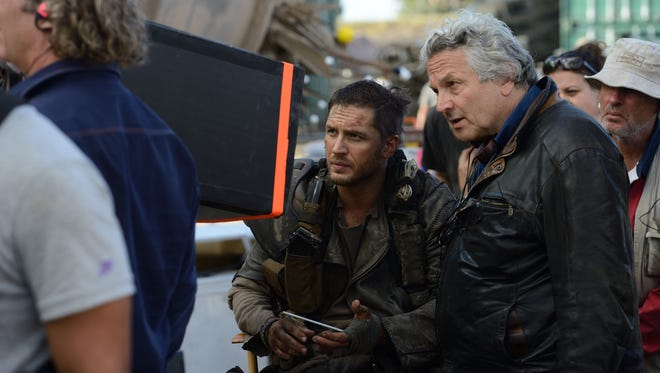"Tom Hardy (left) and George Miller on the set of ""Mad Max: Fury Road."""