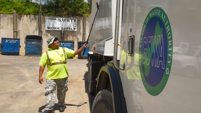 Mr. Rubbishman spotter Mike Miguel scans a Guam Solid Waste Authority packer truck for any radiological signatures prior to the unloading of the vehicle's trash contents at the Mr. Rubbishman compound in Harmon Industrial Park on Tuesday, June 19, 2018. The trash is dropped off by GSWA to be sorted and screened for any unacceptable materials prior to being transported and disposed of at the Layon Landfill.