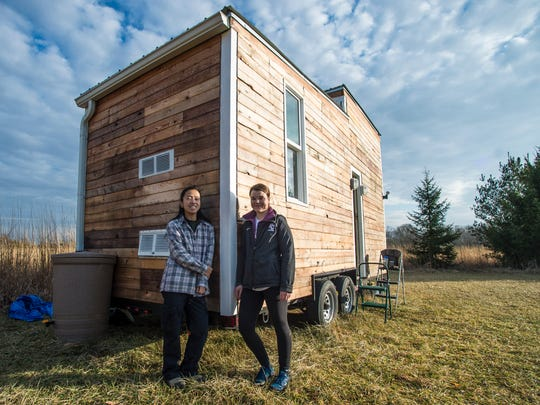 Lily Fishleder and Abby McCullough pose in front of their tiny house in January 2017. Both women have roles with Center City Development Corporation.