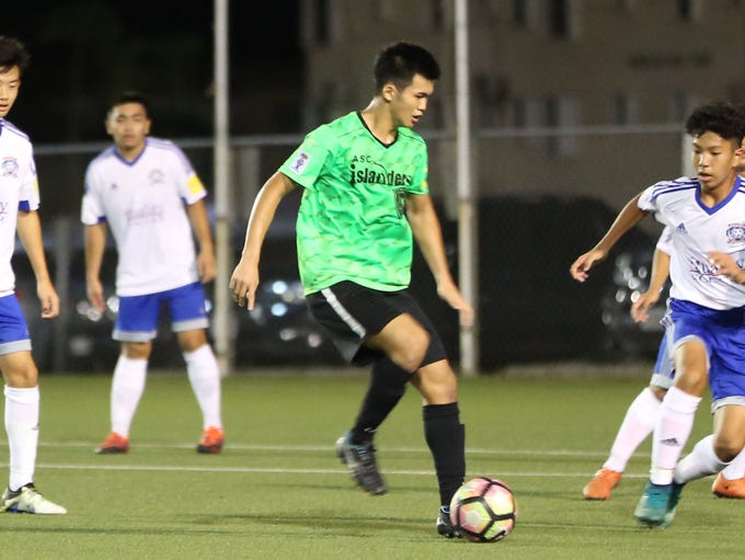 ASC Trust Islanders' Takumi Ito is swarmed by the Quality