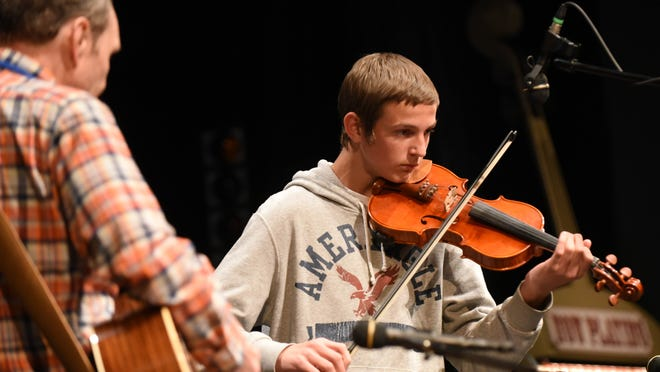James Christof performs during the Oregon Oldtime Fiddlers Association state fiddling championships on Saturday, March 21, at Chemeketa Community College.
