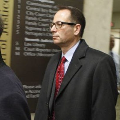 John Maggio leaves court after earlier LDC hearing.