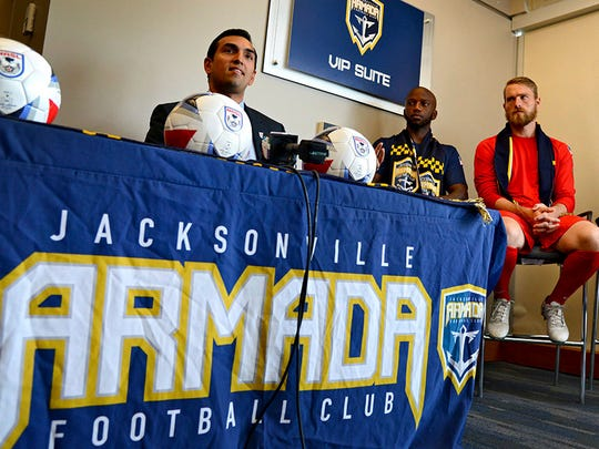 FILE - In this May 4, 2017, file photo, Rishi Sehgal, left, the interim commissioner of the North American Soccer League (NASL), talks about the Jacksonville Armada FC and the search for local ownership as players Jemal Johnson, Caleb Patterson-Sewell, right, listen during a press conference in Jacksonville, Fla. The North American Soccer League canceled its 2018 season after a federal court appeals court denied its attempt to maintain second-tier status, the league announced Tuesday, Feb. 27, 2018. Three NASL teams, the Jacksonville Armada, Miami FC and the New York Cosmos, intend to play this year in the National Premier Soccer League, which has not been designated as part of the USSF soccer pyramid. (Bob Mack/The Florida Times-Union via AP, File)