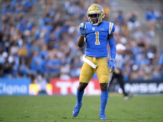 PASADENA, CA - SEPTEMBER 01:  Darnay Holmes #1 of the UCLA Bruins reacts after breaking up a play against the Cincinnati Bearcats at Rose Bowl on September 1, 2018 in Pasadena, California.  (Photo by Harry How/Getty Images)