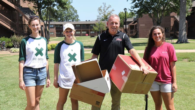 """Union University President Samuel """"Dub"""" Oliver and current students Lauren Howard, Anna Strand and Aubrie Brister assisted new students during Friday's move-in day at Union."""