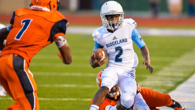 Ridgeland quarterback Cam Mayberry looks to get out of bounds against Callawy during Friday's game.