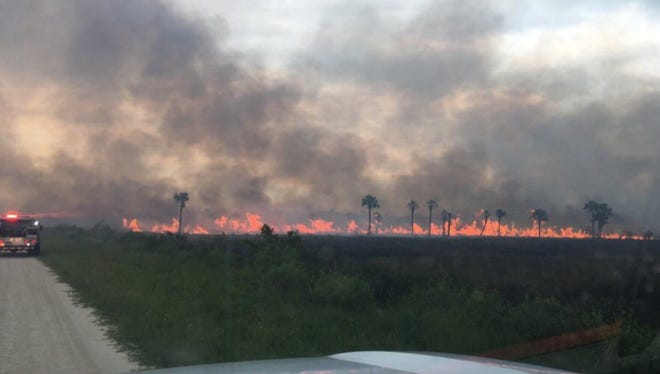 Firefighters contained a 120-acre brush fire Saturday at Merritt Island National Wildlife Refuge.