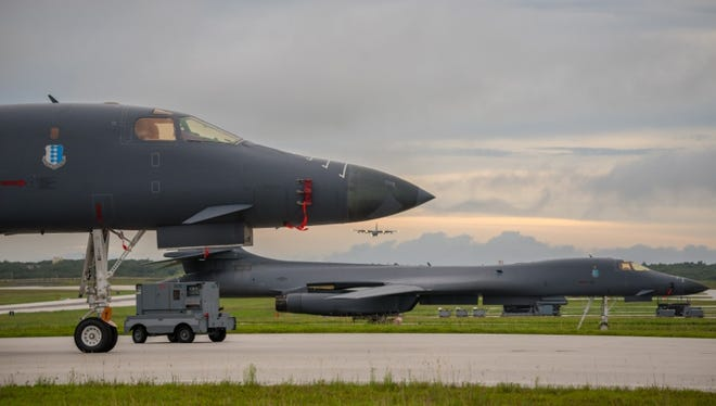 Two U.S. Air Force B-1B Lancers assigned to the 37th Expeditionary Bomb Squadron, deployed from Ellsworth Air Force Base (AFB), S.D., prepare to take off from Andersen AFB, Guam to fly sequenced bilateral missions with two Japan Air Self-Defense Force (JASDF) F-15s and two Republic of Korea air force (ROKAF) F-15Ks in the vicinity of the Sea of Japan, Oct. 10, 2017. This mission marks the first time U.S. Pacific Command B-1B Lancers have conducted combined training with JASDF and ROKAF fighters at night, demonstrating our increasing combined capabilities.