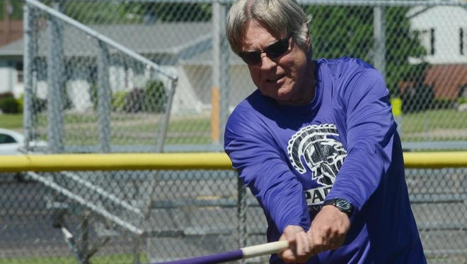 Lakeview varsity baseball coach Jeff Sovern hits balls for infielders during a recent practice. Sovern  has stepped down as coach of Lakeview after 13 seasons.