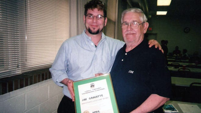 Big Jim Gravatte, right, with son Jay Gravatte, after Jim Gravatt was named Germantown-Paristown Citizen of the Year in 2008. Photo by Judy Magre.