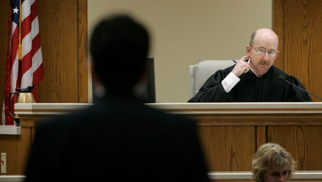 Manitowoc County Circuit Judge Patrick Willis listens to Steven Avery's defense attorney Dean Strang in the courtroom during the Steven Avery trial on March 8, 2007 at the Calumet County Courthouse in Chilton.