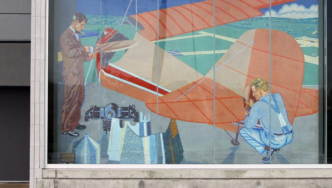 Winold Reiss created this mosaic for Union Terminal. It's now re-installed on the west face of the Duke Energy Convention Center. This is a scene from the Aeronautical Corp. of America, which built aircraft at Lunken Airport.