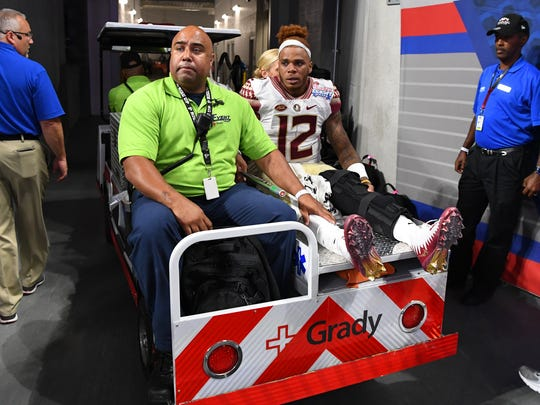 Florida State quarterback Deondre Francois carted off