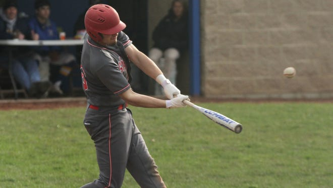 Shelby's Carter Brooks makes contact with the ball while playing at Ontario on April 4, 2017.