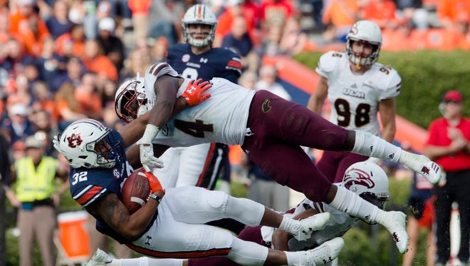 True freshman linebacker Rashaad Harding (4) was pressed into a bigger role at Auburn and made eight tackles.