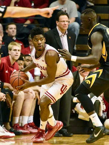 Robert Johnson (4) scored 13 points for Indiana.