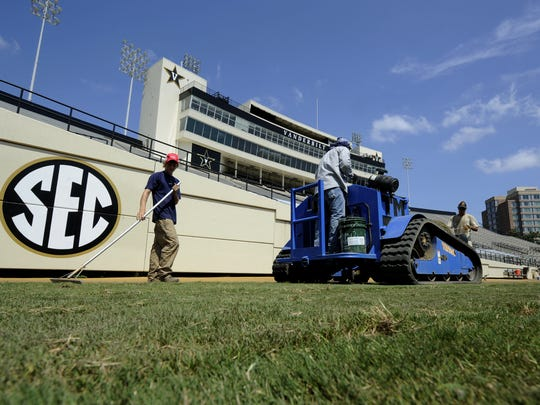 Workers from Sports Turf Solutions, the company leading the re-sodding, and Tri Turf Sod, lay new grass at Vanderbilt Stadium July 14, 2011. The 80,000 square feet of turf needed to be replaced after a recent U2 concert.
