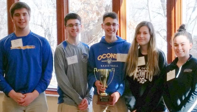 Members of the Oconto High School Lifesmarts team hold their trophy after winning the state championship on March 2 are, from left, Lucas Ruechel, James Alwin, Alex Maynard, Karly Murphy and Morgan Durand. Karly Murphy, and Morgan Durand.