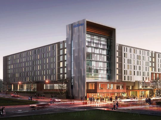 A digital rendering, looking northeast, shows the Hilton convention hotel under construction in downtown Des Moines. It will be eight stories tall.