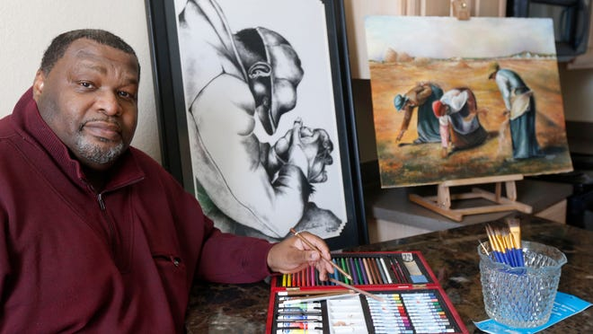 "Artist Leonard ""Rusty"" Medlock is shown with some of his artwork at his home in DeSoto, Texas. A former prison inmate, he relearned his passion while incarcerated."