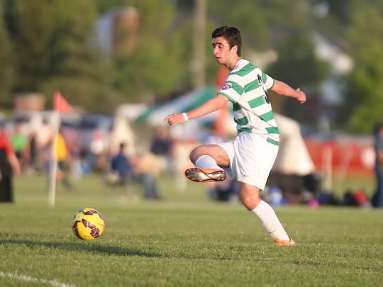 Ahmad Chouman of the Canton Celtic 00 Black team boots the ball during Friday's game against AC Milan Detroit 99. Canton won 1-0.