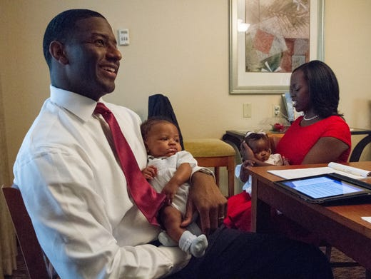 Newly-elected mayor Andrew Gillum prepares his speech as he holds the 14-week-old Jackson Gillum at DoubleTree on Tuesday, August 26, 2014. Tallahassee downtown hotel [19659123] Tallahassee residents and visitors filled Florida A & M