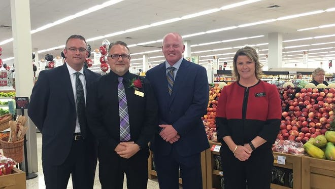 Pictured from left to right are Nate Swalley, Sioux Falls Hy-Vee on South Sycamore Avenue store director; Dan Rost; Nate Stewart, Hy-Vee senior vice president and Kristi Masterson, district vice president of Hy-Vee's northwest area.