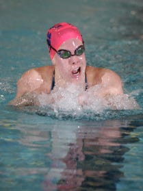 Greta Leberfinger of Chatham swims the 100-yard breaststroke.