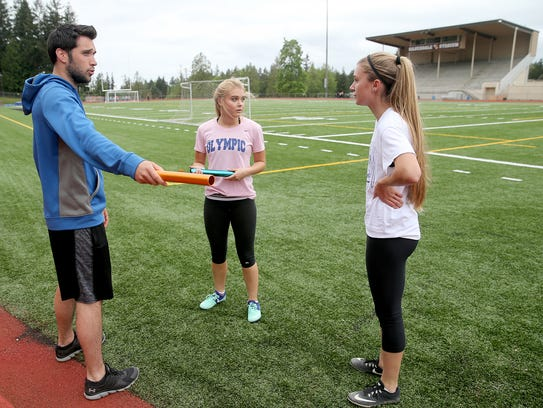 Olympic track and field coach Travis Quinn (left) recently lost 25 students to academic suspension.