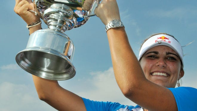 Lexi Thompson holds high her trophy after winning the Navistar LPGA Classic on the Robert Trent Jones Golf Trail at Capitol Hill in Prattville, Ala., on Sunday September 18, 2011. (Montgomery Advertiser, Lloyd Gallman)