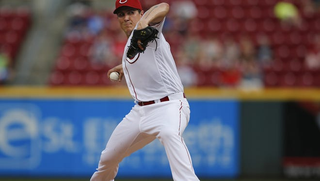 Cincinnati Reds starting pitcher Homer Bailey (34) delivers to the plate in the first inning during the MLB National League game between the Miami Marlins and the Cincinnati Reds, Wednesday, Aug. 17, 2016, at Great American Ball Park in Cincinnati.