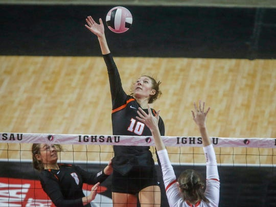 West Des Moines Valley junior Madi Kubik knocks the ball over the net against Cedar Falls in the Class 5A championship match during the 2017 Iowa high school state volleyball tournament on Friday, Nov. 10, 2017, in Cedar Rapids.